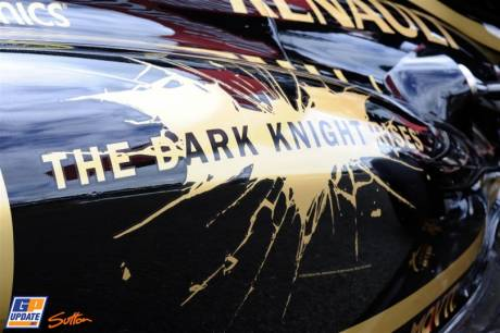 The Lotus F1 Team E20 with advertising for 'The Dark Knight Rises'