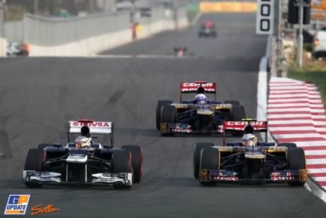 Pastor Maldonado (Williams F1 Team, FW34) leading Jean-Eric Vergne and Daniel Ricciardo (Scuderia Toro Rosso, STR7)
