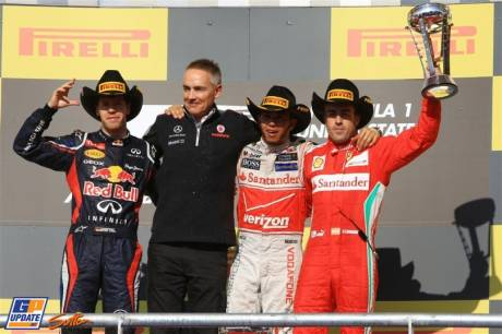 The Podium : Second Place Sebastian Vettel (Red Bull Racing), Race Winner Lewis Hamilton (McLaren Mercedes) and Third Place Fernando Alonso (Scuderia Ferrari)