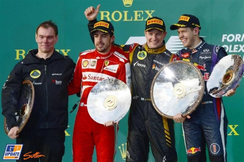 The Podium : Alan Permane (Lotus F1 Team), Second Place Fernando Alonso (Scuderia Ferrari), Race Winner Kimi Räikkönen (Lotus F1 Team) and Third Place Sebastian Vettel (Red Bull Racing)