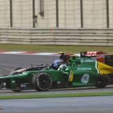Giedo van der Garde (Caterham F1 Team, CT02) and Daniel Ricciardo (Scuderia Toro Rosso, STR8)
