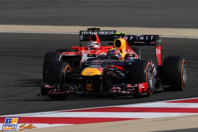 7 Mark Webber (Red Bull Racing, RB9) and Jules Bianchi (Marussia F1 Team, MR02)