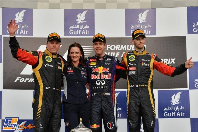 The Podium : Second Place Kimi Räikkönen (Lotus F1 Team), Race Winner Sebastian Vettel (Red Bull Racing) and Third Place Romain Grosjean (Lotus F1 Team)