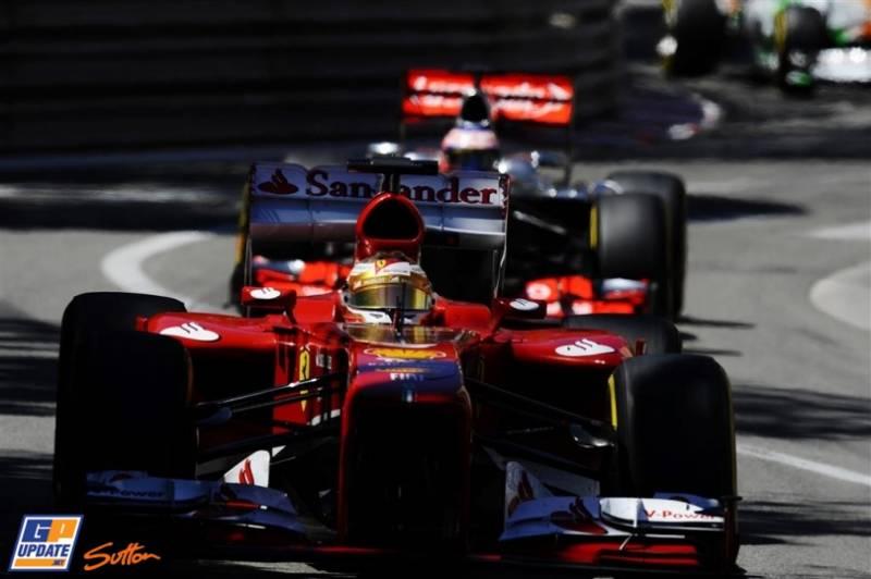 Fernando Alonso (Scuderia Ferrari, F138) and Jenson Button (McLaren Mercedes, MP4-28)