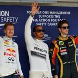 The Top Three Qualifiers : Second Place Sebastian Vettel (Red Bull Racing), Pole Position Lewis Hamilton (Mercedes AMG F1 Team) and Third Place Romain Grosjean (Lotus F1 Team)