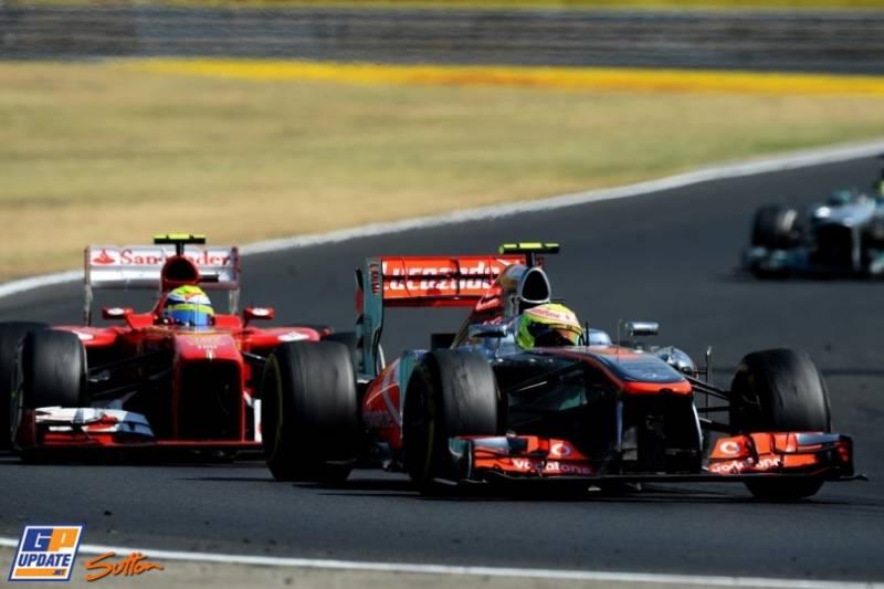 Sergio Perez (McLaren Mercedes, MP4-28) and Felipe Massa (Scuderia Ferrari, F138)