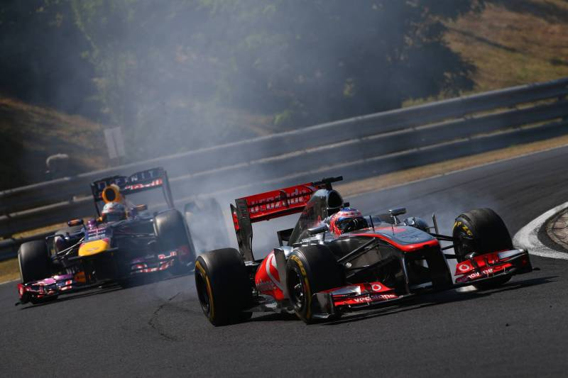Jenson Button (McLaren Mercedes, MP4-28 and Sebastian Vettel (Red Bull Racing, RB9)