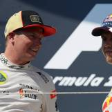 Kimi Räikkönen (Lotus F1 Team) and Sebastian Vettel (Red Bull Racing)