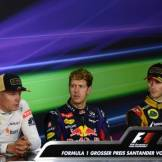 The Top Three Finishers : Second Place Kimi Räikkönen (Lotus F1 Team), Race Winner Sebastian Vettel (Red Bull Racing), Romain Grosjean (Lotus F1 Team)