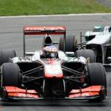 Jenson Button (McLaren Mercedes, MP4-28) and Lewis Hamilton (Mercedes AMG F1 Team, F1 W04)