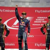 The Podium : Second Place Kimi Räikkönen (Lotus F1 Team), Race Winner Sebastian Vettel (Red Bull Racing) and Third Place Romain Grosjean (Lotus F1 Team)