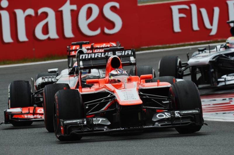Jules Bianchi (Marussia F1 Team, MR02) and Jenson Button (McLaren Mercedes, MP4-28)