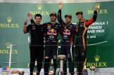 The Podium : Second Place Mark Webber (Red Bull Racing), Race Winner Sebastian Vettel (Red Bull Racing) and Third Place Romain Grosjean (Lotus F1 Team)