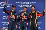 The Top Three Qualifiers : Second Place Mark Webber (Red Bull Racing), Pole Position Sebastian Vettel (Red Bull Racing) and Third Place Romain Grosjean (Lotus F1 Team)
