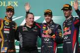 The Podium : Second Place Romain Grosjean (Lotus F1 Team), Race Winner Sebastian Vettel (Red Bull Racing) and Third Place Mark Webber (Red Bull Racing)
