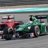 Marcus Ericsson (Caterham F1 Team, CT04) and Kimi Räikkönen (Scuderia Ferrari, F14 T)