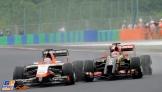 Romain Grosjean (Lotus F1 Team, E22) and Jules Bianchi (Marussia F1 Team, MR04)