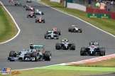 Nico Rosberg (Mercedes AMG F1 Team, F1 W05) leads Jenson Button and Kevin Magnussen (McLaren Mercedes, MP4-29)