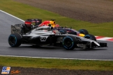 Kevin Magnussen (McLaren Mercedes, MP4-29) and Sebastian Vettel (Red Bull Racing, RB10)