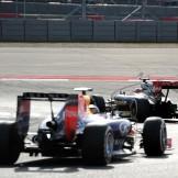 Romain Grosjean (Lotus F1 Team, E22) leads Sebastian Vettel (Red Bull Racing, RB10)