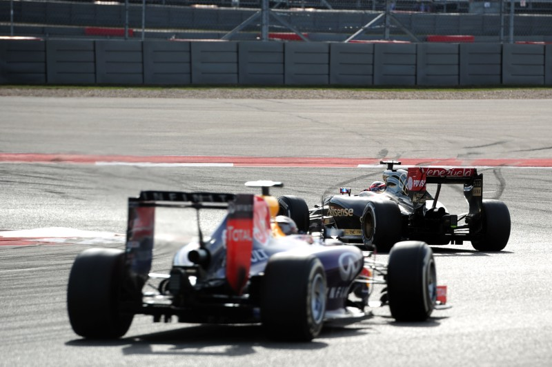Romain Grosjean (Lotus F1 Team, E22) leads Sebastian Vettel (Red Bull Racing, RB10)
