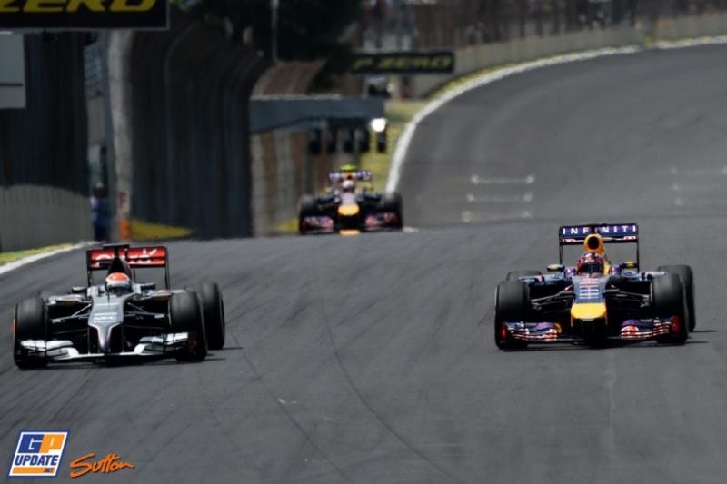 Adrian Sutil (Sauber F1 Team, C33) and Sebastian Vettel (Red Bull Racing, RB10)