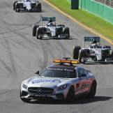 The FIA Safety Car leading the Field