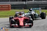 Sebastian Vettel (Scuderia Ferrari, SF15-T) and Nico Rosberg (Mercedes AMG F1 Team, F1 W06 Hybrid)
