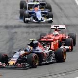 Carlos Sainz Jr. (Scuderia Toro Rosso, STR10) followed by Sebastian Vettel (Scuderia Ferrari, SF15-T)