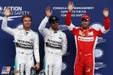 The Top Three Qualifiers : Second Place Nico Rosberg (Mercedes AMG F1 Team), Pole Position Lewis Hamilton (Mercedes AMG F1 Team) and Third Place Sebastian Vettel (Scuderia Ferrari)