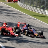 Kimi Räikkönen (Scuderia Ferrari, SF15-T) and Carlos Sainz Jr. (Scuderia Toro Rosso, STR10)