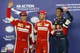 The Top Three Qualifiers : Third Place Kimi Räikkönen (Scuderia Ferrari), Pole Position Sebastian Vettel (Scuderia Ferrari) and Second Place Daniel Ricciardo (Red Bull Racing)