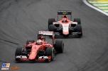 Sebastian Vettel (Scuderia Ferrari, SF15-T) and Alexander Rossi (Manor Marussia F1 Team, MR03)