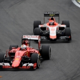 Sebastian Vettel (Scuderia Ferrari, SF15-T) and Alexander Rossi (Manor Marussia F1 Team, MR03)