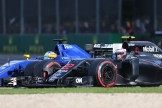 Jenson Button (McLaren Honda, MP4-32) and Marcus Ericsson (Sauber F1 Team, C35)
