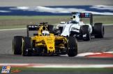 Kevin Magnussen (Renault F1 Team, RS16) and Felipe Massa (Wiliams F1 Team, FW38)