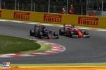 Carlos Sainz Jr. (Scuderia Toro Rosso, STR11) and Kimi Räikkönen (Scuderia Ferrari, SF16-H)