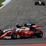 Sebastian Vettel (Scuderia Ferrari, SF16-H) and Nico Rosberg (Mercedes AMG F1 Team, F1 W07 Hybrid)