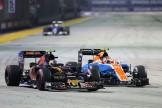 Carlos Sainz Jr. (Scuderia Toro Rosso, STR11) and Esteban Ocon (Manor Racing Team, MRT05)