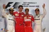 The Podium : Second Place Lewis Hamilton (Mercedes AMG F1 Team), Race Winner Sebastian Vettel (Scuderi Ferrari) and Third Place Valtteri Bottas (Mercedes AMG F1 Team)