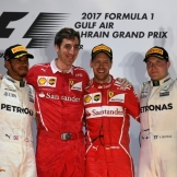 The Podium : Second Place Lewis Hamilton (Mercedes AMG F1 Team), Race Winner Sebastian Vettel (Scuderi Ferrari) and Third Place Valtteri Bottas (Mercedes AMG F1 Team)