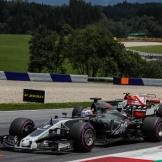 Romain Grosjean (Haas F1 Team, VF17) and Kimi Räikkönen (Scuderia Ferrari, SF70-H)
