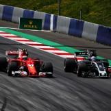 Kimi Räikkönen (Scuderia Ferrari, SF70-H) and Romain Grosjean (Haas F1 Team, VF17)