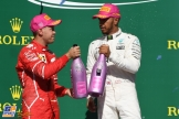 The Podium : Second Place Sebastian Vettel (Scuderia Ferrari) and Race Winner Lewis Hamilton (Mercedes AMG F1 Team)