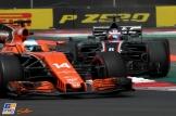 Fernando Alonso (McLaren Honda, MCL32) and Romain Grosjean (Haas F1 Team, VF17)