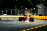 A Red Bull Racing RB14 throwing sparks