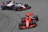 Kimi Räikkönen (Scuderia Ferrari, SF71H) and Kevin Magnussen (Haas F1 Team, VF18)