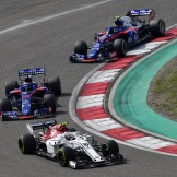 Charles Leclerc (Sauber F1 Team, C37) and Pierre Gasly and Brandon Hartley (Scuderia Toro Rosso, STR13)