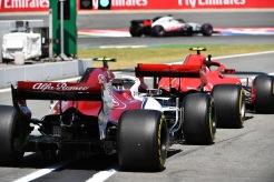 A Sauber F1 Team C37 and a Scuderia Ferrari SF71H in the Pits