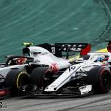 Kevin Magnussen (Haas F1 Team, VF18) and Marcus Ericsson (Sauber F1 Team, C37)
